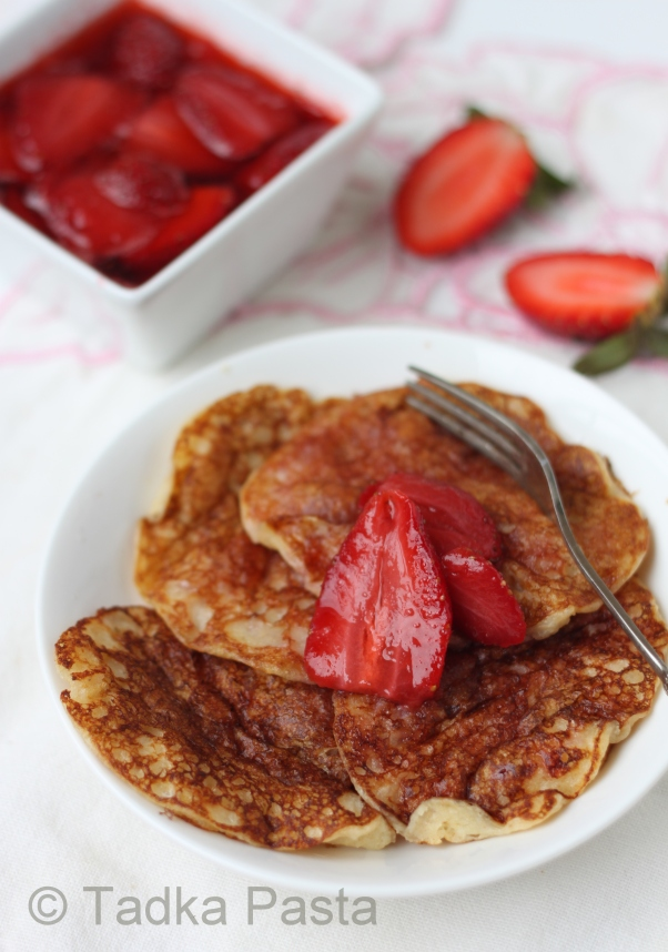 Oatmeal pancakes with syrupy strawberries